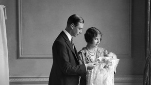The Queen Mother,with her husband King George VI (then the Duke of York) and their daughter Princess Elizabeth at her christening.