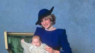 Prince Harry, as a three month old baby, on his mother's knee on his Christening day, December 21, 1984.
