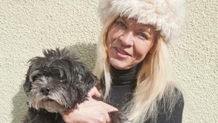Jayne holding a grey dog