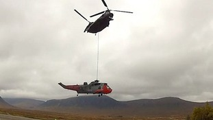 The Chinook transferred the Sea King to a waiting low loader.