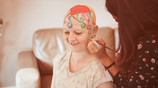 Women fighting cancer share hope with unique artwork on their heads