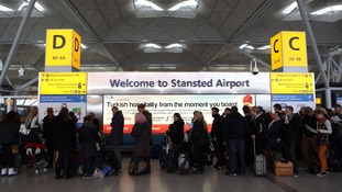 Passengers at Stansted Airport in Essex