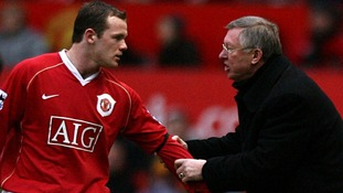 Sir Alex Ferguson gives instructions to Wayne Rooney