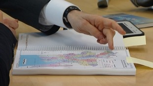 Primark's Paul Lister shows Laura Kuenssberg a map showing where the 550 workers are living now
