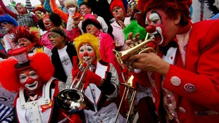 Clowns play music as they rally for peace during the 18th Latin American clown convention