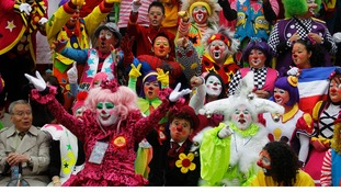 Clowns pose for a photo