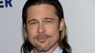 "ile photo, actor Brad Pitt arriving at the Los Angeles premiere of the play ""8"" in Los Angeles."