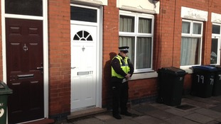 Police are stationed outside the house in Coventry