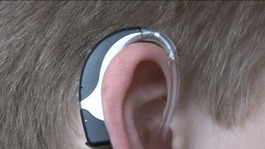 Young person with a hearing aid