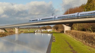 An artist's impression of the new HS2 rail line speeding through the countryside