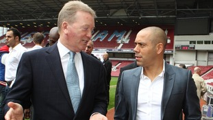 Frank Warren promoter of Dereck Chisora talks with Adam Booth, trainer and Manager of David Haye
