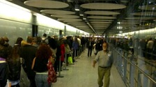 Passengers are forced to queue at London's Heathrow Airport