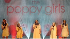 The Poppy Girls perform at the launch of the Poppy Appeal 2013.