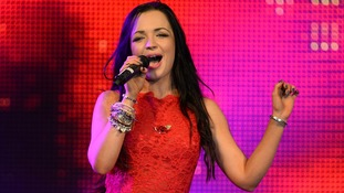 Tich performs at a concert at RAF Northolt to launch the Royal British Legion's Poppy Appeal 2013.