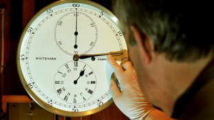 Horologist Francis Brodie checks one of the 500 working clocks in the Science Museum