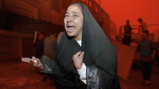 An Iraqi woman is distraught after a missile strike on a street market killed her husband in the Al Shabab district.