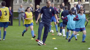 Prince William plays football at Buckingham Palace recently.