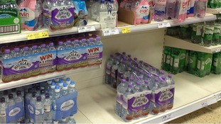 Much of the stock of large bottles of water has gone at the Tesco in Spring Hill