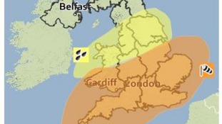 The Met Office's yellow alert for rain and amber alert for wind shown across much of England and Wales.