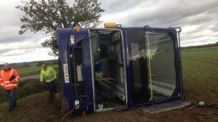 "A double-decker bus ""rolled over"" in Suffolk, injuring the driver and several passengers."