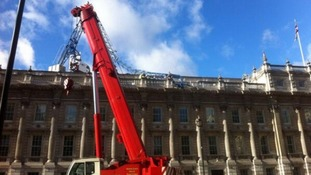A second crane has been moved in to help remove the remnants of a damaged one on the roof of the Cabinet Office