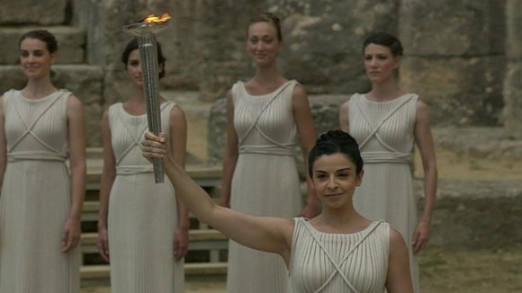 "The ""high priestess"" lights the Olympic flame."