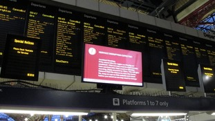 The departure boards at Victoria train station yesterday during rush hour.