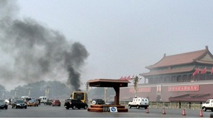Chinese officials suspect yesterday's fatal car crash was the result of a suicide attack, according to Reuters sources.