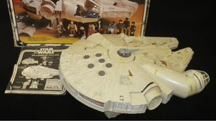 Not a piece of junk! The Millenium Falcon, above, with its original packaging.