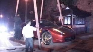 Ferrari 458 Italia being lifted from the ancient wall