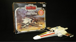 Retro: A 'Battle Damaged' X-Wing Fighter being sold in the lot.