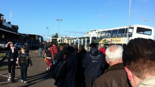 Passengers wait for buses at Ipswich railway station.