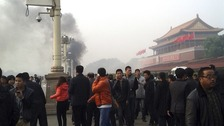 Smoke rises in front of the main entrance of the Forbidden City at Tiananmen Square.