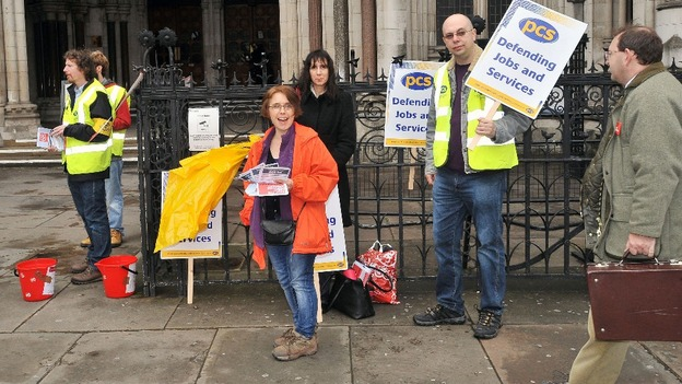 Members of the Public and Commercial Services Union protest outside the High Court