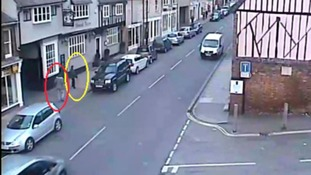 Andrew Ratcliffe (circled in red) and Mary Roberts (circled in yellow) outside the St Edmunds Tavern.