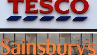 A Tesco and a Sainsbury's sign.