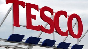 A Tesco sign.
