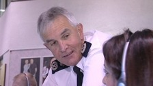 Peter Fahy talking to colleague