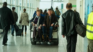 Dame Judi Dench and Steve Coogan during filming at Stansted