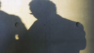 Two men's shadows.