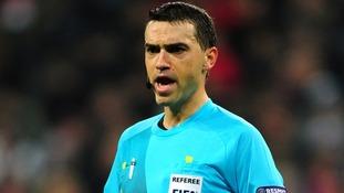 Referee Ovidiu Hategan .