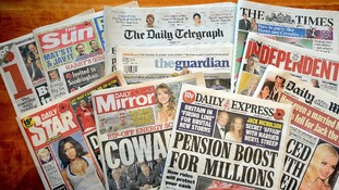 The UK's national newspapers spread out.
