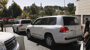 OPCW weapons inspectors, seen here in a convoy in Damascus, have verified 21 of 23 sites declared by Syria