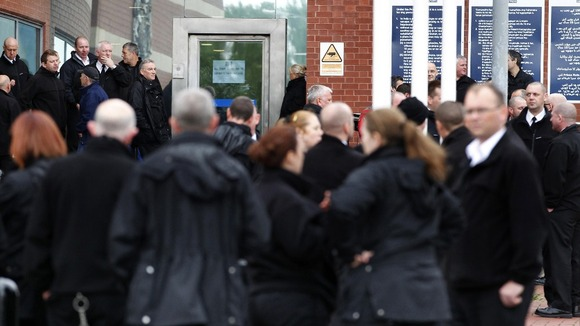 Prison staff take part in a protest outside HMP Manchester
