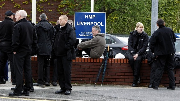 Prison officers stand outside HMP Liverpool Prison in Walton