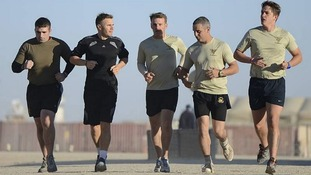 Gary Barlow on a five kilometre run with British troops at Camp Bastion, Afghanistan