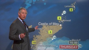 Prince Charles presents a special weather forecast during a visit to BBC Scotland