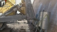 Syrian State TV showed these pictures of gas canisters being destroyed.