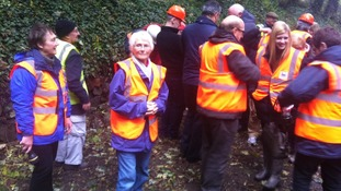 Visitors get their hi-vis vests ready to go into the tunnel