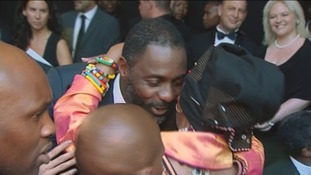 Winnie Madikizela-Mandela embraces Idris Elba at the world premiere of Mandela: Long Walk to Freedom.